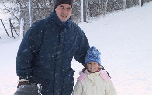 Family fun on Beren's sled hill.