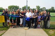 Elmhurst College President, Park District Executive Director and Elmhurst College staff celebrate ribbon cutting