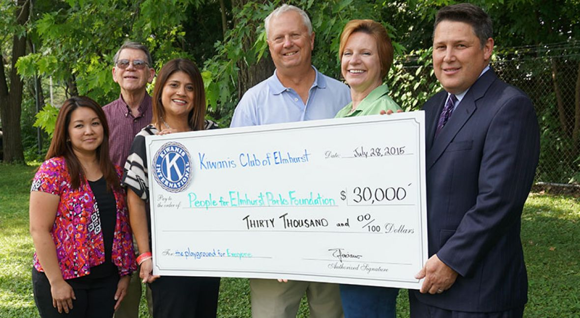 The Kiwanis Club of Elmhurst present check to the People for Elmhurst Parks Foundation. From left to right: Emmylou Feliciano, Treasurer; Jim Williams, Division 9 Lt. Governor; Angela Villegas, President Elect; Pete Goworowski, President of The People for Elmhurst Parks Foundation; Anne Quigley, Immediate Past President; Ted Barnhart, President.
